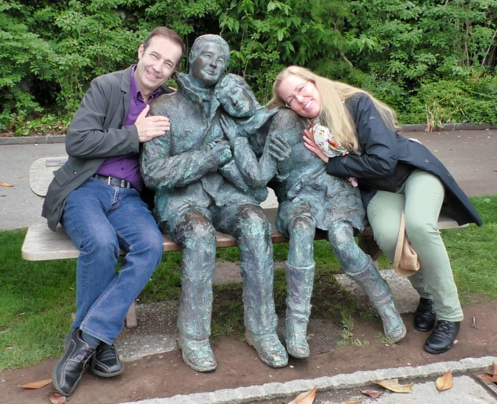 Mitch and Dina sitting with couple statue Montreux, Lake Geneva, Switzerland, 2019